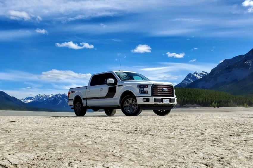 Ford F-150 truck in mountain river bed