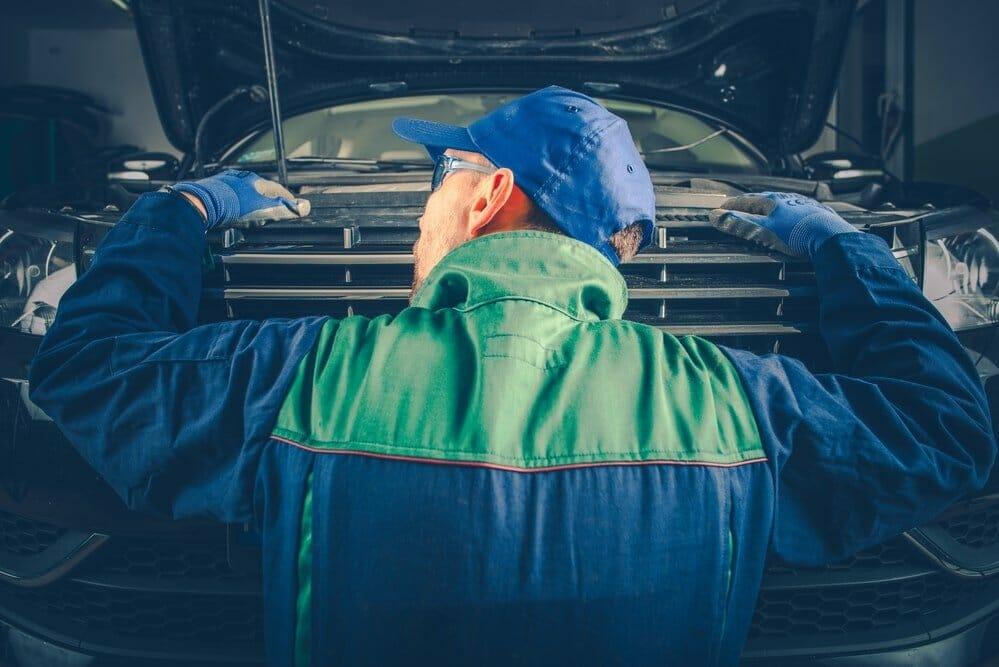 Engine Noises Listening by Professional Car Mechanic