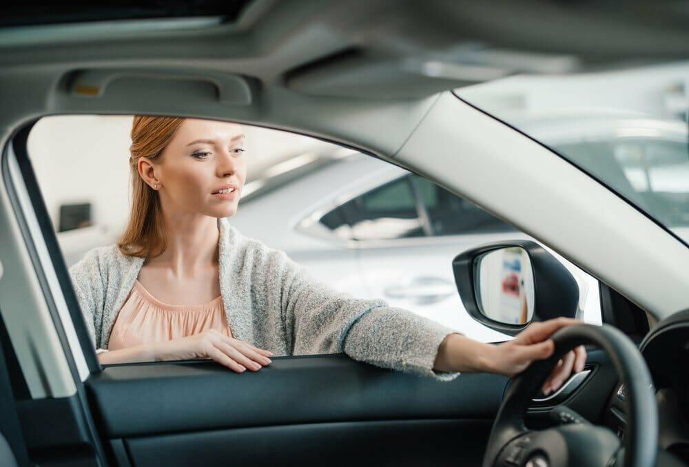 Woman choosing car