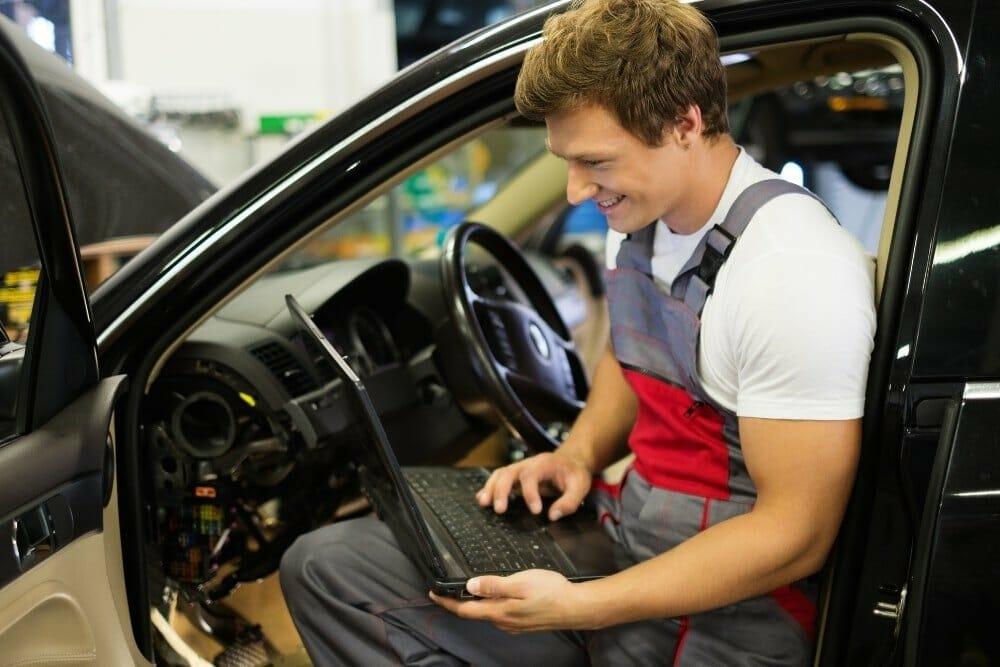man doing a car diagnostic test